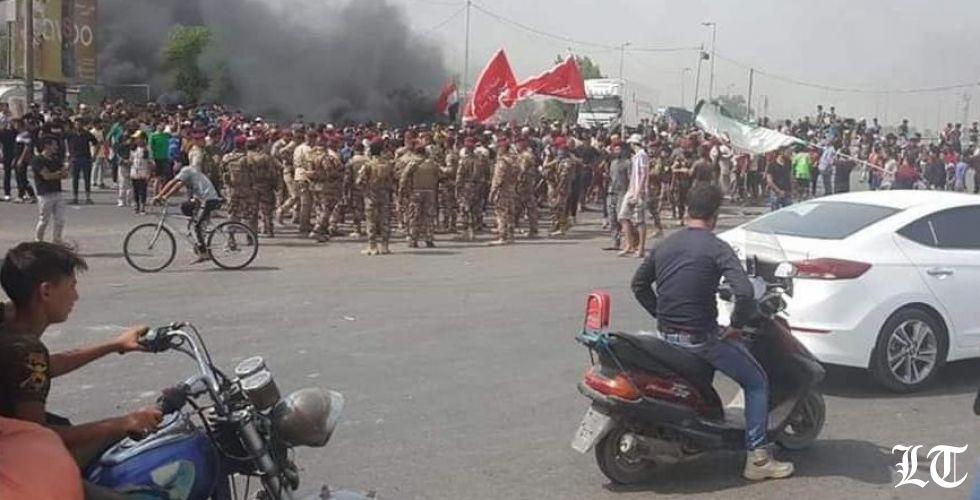 الحكومة العراقية في مأزق منع التجوال في بغداد والمحتجون الى خرقه